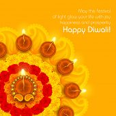 stock photo of marigold  - illustration of decorated Diwali diya on flower rangoli - JPG