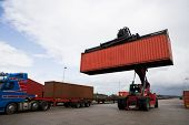 Crane lifts a container