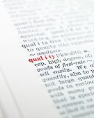 The word 'quality' highlighted in a dictionary