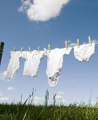 Baby Clothing on a clothesline towards blue sky