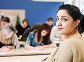 Schoolteacher in front of pupils in the classroom