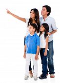 Happy family pointing away - isolated over a white background