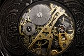 stock photo of wind up clock  - Watch mechanism very close up  - JPG