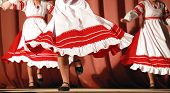 Bright Fragment Of Fast Russian Folk Dance With Red-white Girls Waved Skirt