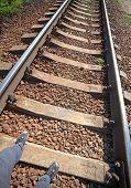Legs Of A Man Walking On The Railway