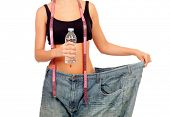 Slim woman back with huge pants and water bottle isolated on white background
