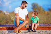 Father And Son Talking, Summer Outdoor