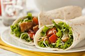 stock photo of sandwich wrap  - Breaded Chicken in a Tortilla Wrap with Lettuce and Tomato - JPG