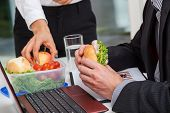 image of lunch box  - Managers with healthy lunch at the desk - JPG