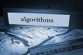 The word algorithms on blue business binder on a desk