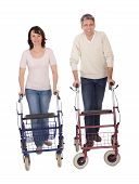 Mature Couple Using Walking Aide