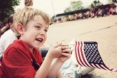 stock photo of parade  - Young boy watching Holiday parade - JPG