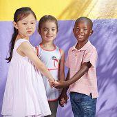 Interracial group of happy children in a kindergarten