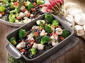 ink squid tagliatelle with sepia and broccoli