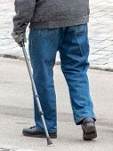 a man with a walking stick to help with walking difficulties eienr