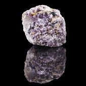 Single Mineral Lepidolite Close up with reflection on black surface background
