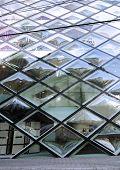 Tokyo - November 24: Rhomboid-grid glass building on Omotesando Street