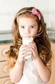 Beautiful Smiling Little Girl Drinking Milk