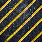 metal plate with black and yellow stripes