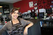 Portrait of beautiful waitress in coffee shop