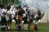 foto of revolutionary war  - Colonial Militiamen Fire a Volley during a Revolutionary War Reenactment - JPG
