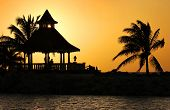 stock photo of beachfront  - A Silhouette of Gazebo at Sunset - JPG