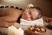 Portrait of young female relaxing in beauty salon