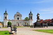 stock photo of hetman  - Town square in Tykocin in Poland Church of the Holy Trinity and monument to hetman Stefan Czarniecki - JPG