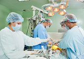 picture of heart surgery  - Team of surgeon in uniform perform heart transplantation operation on a patient at cardiac surgery clinic - JPG