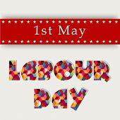 Colorful shiny text Labour Day on red and grey background.