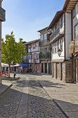 Guimaraes, Portugal - October 13, 2013: Medieval street of the Historical Center of Guimaraes. UNESC