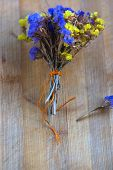 Bouquet Of Dried Flowers On The Striped Board