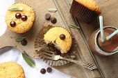 pic of wheat-free  - Delicious homemade gluten free muffins with chocolate drops on wooden chopping board