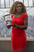 US Open 2014 champion Serena Williams posing with US Open trophy on the top of Empire State building