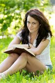 Student With A Book In The Park