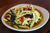foto of green papaya salad  - green papaya salad or Som tum is local food Northeast of Thailand.