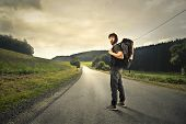 Man with a backpack ready to walk a long road