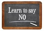 learn to say no advice on a vintage slate blackboard