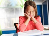 little girl having difficulty with home work