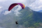 image of annecy  - paraglider flying in the French Alps of Annecy