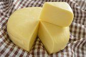 Suluguni cheese round on a towel