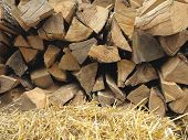 Background Of Dry Chopped Firewood Logs And Hay