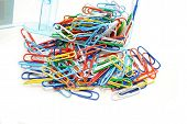 Colorful Paper Clips Spilling Out Of A Box