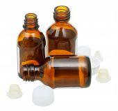 Three Empty Open Brown Glass Pharmacy Bottles