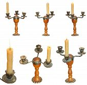 foto of flambeau  - set of candleholder with candles isolated on white background - JPG