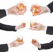 Set Of Whiskey Glass In Businessman Hand