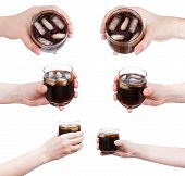 Set Of Hand Holds Soft Drink With Ice In Glass