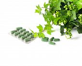 Herbal Medicine Pills With Green Plant