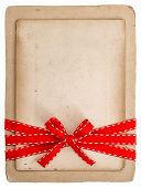 Vintage Card With Red Ribbon Bow Isolated On White