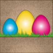 Easter Composition With Colorful Eggs Over Recycled Cardboard